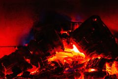 Close up view of burning coal from burning wood in fireplace. stock photos