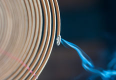 Burning spiral incense stick in temple. Stock Photo
