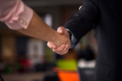 Close up view of business partners shaking hands. Royalty Free Stock Image