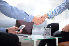 Close up view of business partnership handshake concept.Photo of two businessman handshaking process.Successful deal. Close up view of business partnership Royalty Free Stock Images