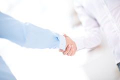 Close up view of business partnership handshake concept.Photo of two businessman handshaking process.Successful deal. Close up view of business partnership Royalty Free Stock Photos
