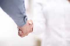 Close up view of business partnership handshake concept.Photo of two businessman handshaking process.Successful deal. Close up view of business partnership Stock Photography