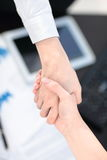 Close up view of business partnership handshake concept.Photo of two businessman handshaking process.Successful deal. Close up view of business partnership Royalty Free Stock Photography