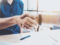 Close up view of business partnership handshake concept.Photo two businessman handshaking process.Successful deal after stock photography