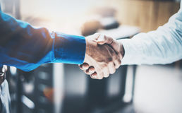 Close up view of business partnership handshake concept.Photo  two businessman handshaking process.Successful deal after Stock Images