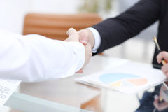 Close up view of business partnership handshake concept.Photo of two businessman handshaking process.Successful deal. After great meeting Stock Photo