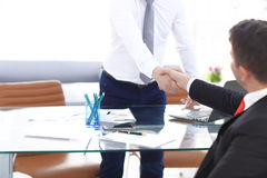 Close up view of business partnership handshake concept.Photo of two businessman handshaking process.Successful deal Stock Images