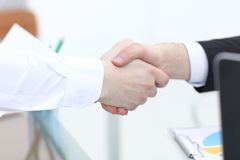 Close up view of business partnership handshake concept.Photo of two businessman handshaking process.Successful deal. After great meeting Stock Images