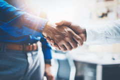 Close up view of business partnership handshake.Concept two businessman handshaking process.Successful deal after great Royalty Free Stock Image