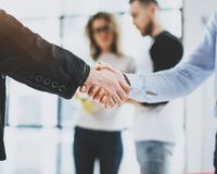 Close up view of business partnership handshake.Concept two coworkers handshaking process.Successful deal after great. Meeting.Blurred background Stock Photo