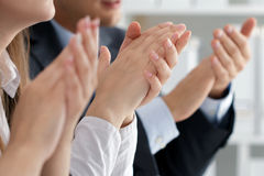Close up view of business seminar listeners clapping hands. Professional education, business meeting, presentation or coaching concept Stock Photography