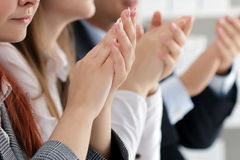 Close up view of business seminar listeners clapping hands. Professional education, business meeting, presentation or coaching concept Royalty Free Stock Photography