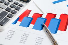 Close up view of business stationery: documents. With diagrams, calculator, pen stock images