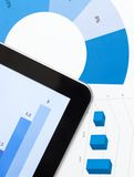 Close up view of business tablet and diagrams Stock Photography