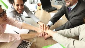 Close up view of business team sitting at the table in the office, folding hands. stock footage