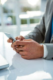 Close up view of a businessman using his phone Royalty Free Stock Images
