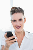 Close up view of businesswoman using smartphone Royalty Free Stock Image