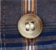 Close up view of a button Stock Photos