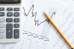 Close up view of calculator, graphs, pencil Stock Photography