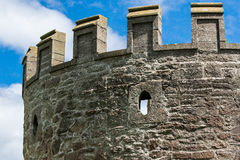 Close-up view of castle turret with sniper holes Royalty Free Stock Image