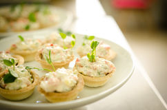 Tartlets with cream cheese salad. Catering services Stock Photo