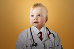 Close up view of Caucasian baby dressed as a doctor Stock Images