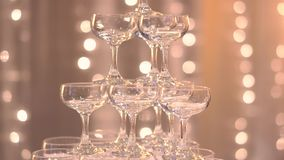 Close up view of champagne glasses  in an interior hotel wedding stock video