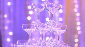 Close up view of champagne glasses  in an interior hotel wedding stock video footage
