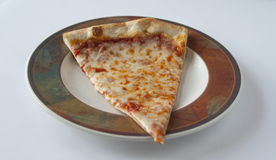 Close up view of Cheese pizza slice Royalty Free Stock Photo