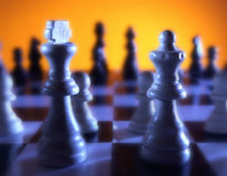 Close up view of chess board with king and queen in foreground Royalty Free Stock Photos
