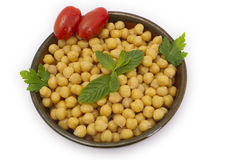 Close up view of chickpea in bowl on white backgro Royalty Free Stock Photos