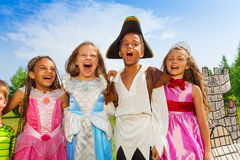 Close up view of children in festival costumes. Close up view of children in different festival costumes having fun together laughing or singing Stock Photo