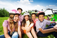 Close up view of children in helmets on  grass Royalty Free Stock Images