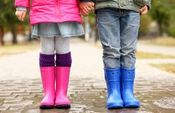 Close up view of children legs in gumboots standing Stock Images