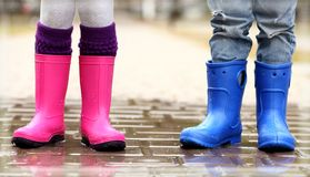 Close up view of children legs in gumboots standing Stock Photography