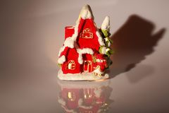 Close up view of christmas decoration isolated. Cute house for candles. Christmas decoration. Postcard. Beautiful christmas backgrounds royalty free stock photo