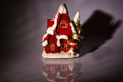 Close up view of christmas decoration isolated. Cute house for candles. Beautiful christmas backgrounds stock image
