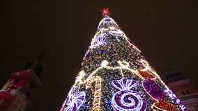 Close up view at Christmas tree, Castle Square in Warsaw. Detailed view at illuminated festive Christmas tree decorated for holidays at square near The Royal stock footage