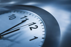 Close-up View of Clock. The top view of a clock that reads four minutes to twelve.  Horizontally framed shot Royalty Free Stock Images
