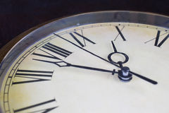 Close up view on a clock face. Of a historical watches with golden frame Stock Photo