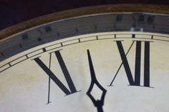 Close up view on a clock face. Of a historical watches with golden frame Royalty Free Stock Images