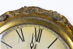Close up view on a clock face. Of a historical watches with golden frame Stock Images