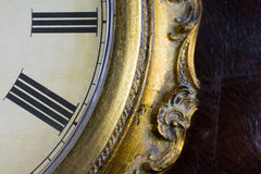 Close up view on a clock face. Of a historical watches with golden frame Stock Photos