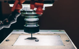 Close-up view of CNC milling machine. Cutting work piece of aluminum with high rotation speed in dark settings with copy space for young advertising text Stock Images