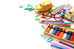 Close up view colorful back to school supplies border over white table. Mental arithmetic. Stock Photos