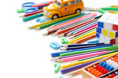 Close up view colorful back to school supplies border over white table. Mental arithmetic. Royalty Free Stock Photo