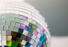 Close up view of colorful disco ball with multicolored reflections. Preparing for a fun night party or holiday at home stock photos