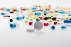 Close-up view of colorful medical pills on white Stock Photo