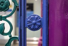 Close up view of colourful wrought ironwork at Smithfield meat and poultry market in the City of London, UK. Detailed view of the colourful wrought ironwork at royalty free stock photos