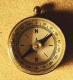 Close up view of the compass on old paper. This image represents Close up view of the compass on old paper Stock Images